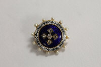 A Victorian blue enamel, seed pearl and diamond brooch.
