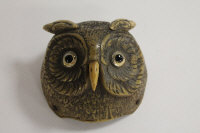 An early twentieth century desk bell modelled as an owl's head, with push action beak, width 9 cm.