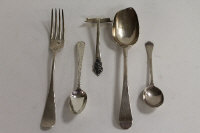 A silver table spoon, London 1772, together with four other items of silver cutlery. (5)