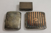 Two silver cigarette cases, together with a silver vesta holder. (3)