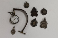 Five silver presentation fobs, together with a silver pocket watch and one other fob. (7)