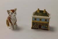 Two Royal Crown Derby English bone china paperweights : The Christmas Box, height 8 cm, and Marmalade Kitten, height 9 cm, both boxed. (2)