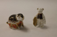 Two Royal Crown Derby English bone china paperweights : Riverbank Beaver, height 8 cm, and Shopping Bear, height 9 cm, both boxed. (2)