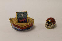 Two Royal Crown Derby English bone china paperweights : Noah's Ark, height 8 cm, and Ladybird, height 4 cm, both boxed. (2)