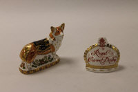 Two Royal Crown Derby English bone china paperweights : Crown Name stand, height 9 cm, and The Royal Windsor Corgi, height 11 cm, both boxed. (2)