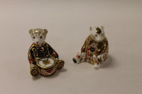 Two Royal Crown Derby English bone china paperweights : Drummer Bear, height 10 cm, and Imari Honey Bear, both boxed. (2)