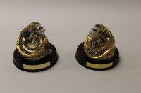 Two Royal Crown Derby English bone china paperweights : Dragon of Good Fortune, height 10 cm, and Dragon of Happiness, height 10 cm, both  with mahogany plinths and boxed. (2)