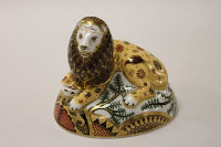 A Royal Crown Derby English bone china paperweight : The Nemean Lion, height 14 cm, boxed.
