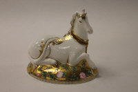 A Royal Crown Derby English bone china paperweight : Mythical Unicorn, height 14 cm, boxed.