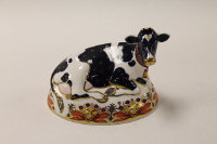 A Royal Crown Derby English bone china paperweight : Friesian Cow, height 12 cm, boxed.