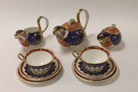 A Royal Crown Derby nine-piece Quail tea set, comprising teapot, sugar bowl, cream jug, two cups, two saucers and two side plates. (9)