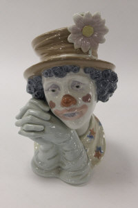 A Lladro china figure - Dreamer Clown, height 29 cm, with mahogany stand, boxed.