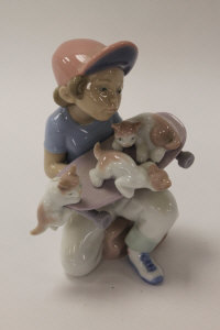 A Lladro china figure - Little Riders, height 15 cm, boxed.