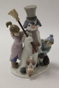 A Lladro china figure - The Snowman, height 21 cm, boxed.