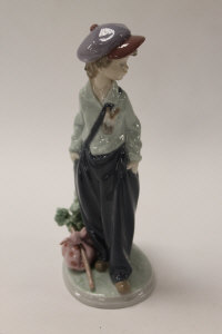 A Lladro china figure - The Wanderer, height 21 cm, boxed.