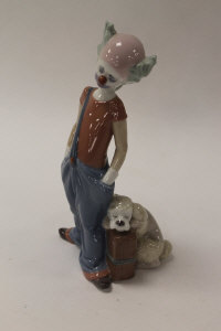 A Lladro china figure - Destination Big Top, height 20 cm, boxed.