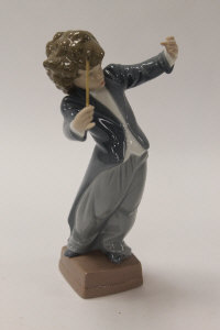 A Lladro china figure - Little Maestro, height 21 cm, boxed.