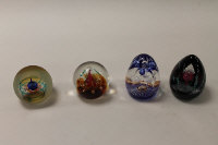 Four Caithness Glass paperweights - Scotia, Millennium Carousel, Fire Brand and Free Fall, all boxed. (4)