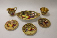 Six pieces of Royal Worcester hand painted gilded china depicting panels of fruit, comprising shaped oblong dish, cream jug, sugar bowl and three side plates. (6)