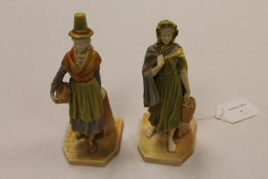 A pair of Royal Worcester figures depicting ladies holding baskets, height 17.5 cm. (2)