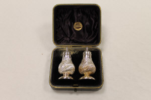 A pair of silver pepper pots, Birmingham 1891, cased.