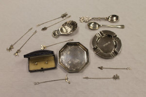 A silver caddy spoon, together with two silver dishes, a pair of 18ct gold studs, two silver teaspoons and eight pickle forks.