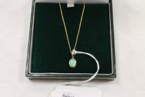 An 18ct gold opal pendant on chain.