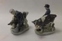 Two Royal Copenhagen china figures - Shepherd boy, height 17 cm, together with a milkmaid, height 16 cm. (2)