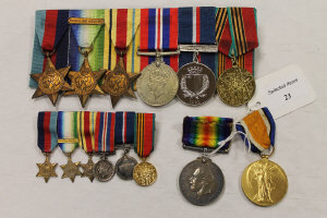 Two WW I medals awarded to W.T. ENG. W.A. Murray. R.N.A, together with a group of six WW II medals on suspension ribbons and the same also in miniature.