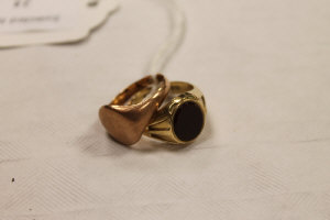 A 9ct gold gentleman's ring set with a carnelian, together with another 9ct gold ring similar. (2)
