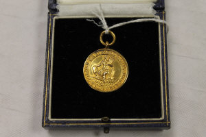 A 9ct gold National Joint Industrial Council for the Flour Milling Industry, 9.2g, cased.