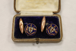 A pair of 9ct gold and enamel cuff links, cased.