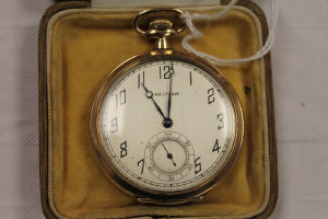 A yellow metal pocket watch by Waltham.