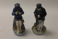 Two Royal Copenhagen china figures - Shepherd boy with his dog, height 18.5 cm, together with a young boy seated on a rock, height 18 cm. (2)