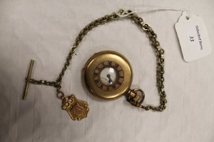 A Swiss gilt metal pocket watch, on white metal chain with 9ct gold fob.