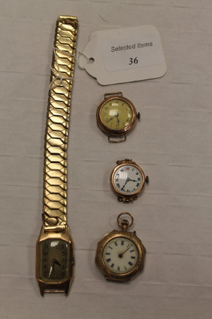 A 9ct gold gentleman's wrist watch, together with a 9ct gold fob watch and two watches. (4)