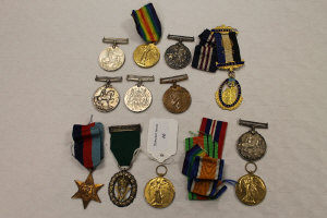 A silver volunteer officer's decoration on green suspension ribbon, together with eleven other WW 1 and later medals. (12)