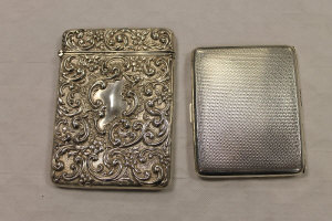 A silver card case, Birmingham 1908, together with a silver cigarette case. (2)
