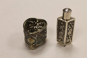 A Chinese silver flask, indistinctly marked, height 7 cm, together with a glass lined silver  salt of the same origins. (2)