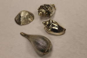 Four Mario Buccelati sterling silver mounted shells. (4)