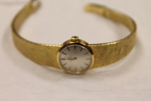 An 18ct gold Omega lady's wrist watch.