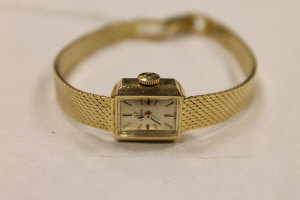 A 14ct gold Omega lady's wrist watch.