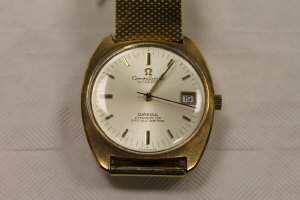 An 14ct gold Omega gentleman's Constellation Automatic wrist watch.