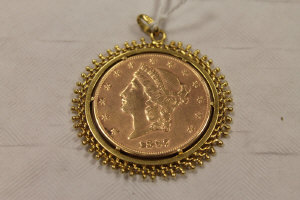 An 1897 United States of America 20 dollar gold coin, mounted as a pendant in yellow metal.