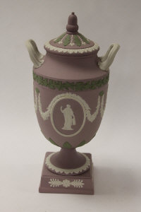A Wedgwood twin handled urn, in mauve jasper ware, height 30 cm, boxed.