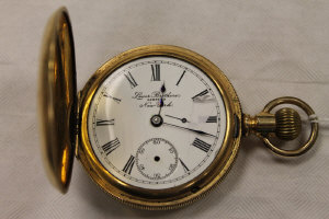 A 14ct gold half hunter pocket watch by Lever Brothers, New York.
