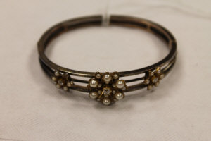 A diamond and pearl cluster bangle.