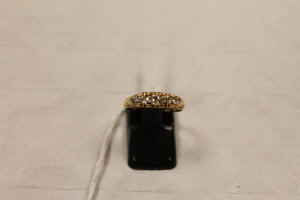 An 18ct gold five stone diamond ring.