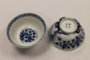 A pair of Chinese blue and white bowls, with floral decoration, four character marks to base, diameter 13.6 cm. (2)