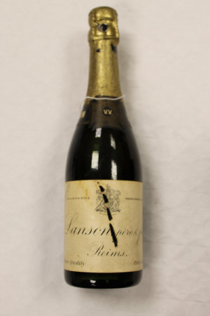 One vintage bottle of Lanson pere & fils  Reims extra dry champagne.
